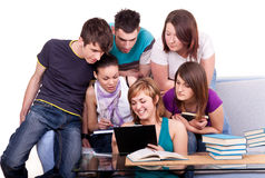Students looking at  book Stock Photo