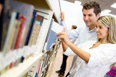 Students looking for a book Stock Images