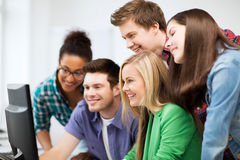 Students looking at computer monitor at school Royalty Free Stock Images
