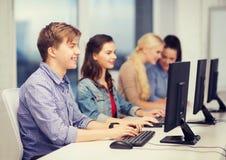 Students looking at computer monitor at school Royalty Free Stock Image