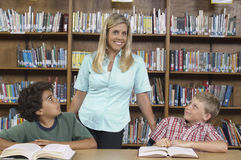 Students Looking At Female Teacher In Library Royalty Free Stock Photo
