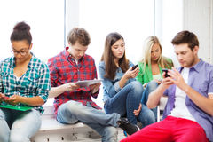 Free Students Looking Into Devices At School Stock Photography - 32889102