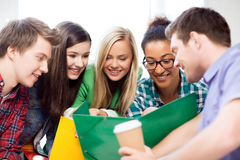 Students looking at notebook at school Royalty Free Stock Photo