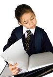 Students looking for notes. A young girl searching for her notes, isolated on white Royalty Free Stock Image