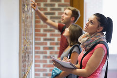 Students looking at notice board Stock Image