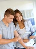 Students looking at pad Royalty Free Stock Photo