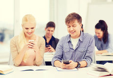 Students looking into smartphone at school Stock Photography