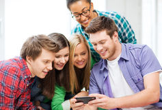 Students looking at smartphone at school Royalty Free Stock Photos