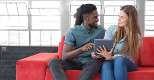 Students looking at tablet in front of windows background Stock Images