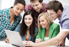 Students looking at tablet pc in lecture at school Stock Images