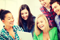 Students looking at tablet pc in lecture at school Royalty Free Stock Image