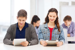 Students looking at tablet pc in lecture at school Royalty Free Stock Images