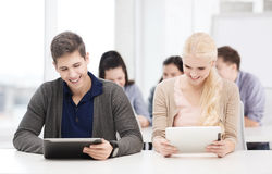 Students looking at tablet pc in lecture at school Royalty Free Stock Photography