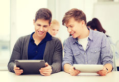 Students looking at tablet pc in lecture at school Stock Photography