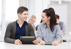 Students looking at tablet pc in lecture at school Royalty Free Stock Photo