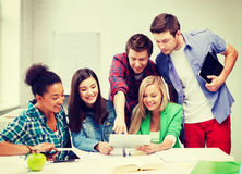 Students looking at tablet pc at school Royalty Free Stock Photo