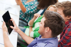 Students looking at tablet pc at school Royalty Free Stock Photos