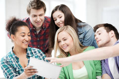Students looking at tablet pc at school Royalty Free Stock Photography