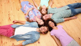 Students lying on floor in a circle stock footage