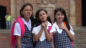 Female Students Making Funny Faces Wearing School Uniforms Stock Photos