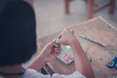 The students are making paper flowers in classroom. Royalty Free Stock Photo