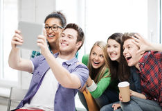Students making picture with tablet pc at school Stock Photography