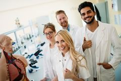 Students of medicine examining anatomical model in classroom Royalty Free Stock Images