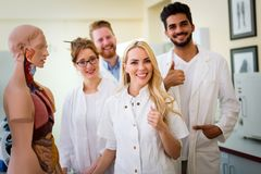 Students of medicine examining anatomical model. In classroom Royalty Free Stock Photo