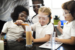 Students Mixing Solution In Science Experiment Class Stock Photography