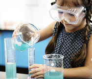 Students Mixing Solution in Science Experiment class. Kindergarten Students Mixing Solution in Science Experiment Laboratory Class Stock Image