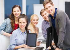 Students with monitor and blank tablet pc screen Stock Photography