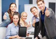 Students with monitor and blank tablet pc screen Stock Photo