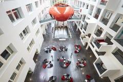 Students moving around the atrium area of modern university Stock Photography