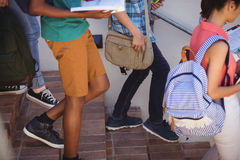 Students moving down staircase. At school Royalty Free Stock Image
