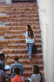 Students moving up staircase Royalty Free Stock Images