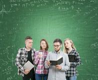 Students near green chalkboard Stock Image