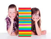 Students next to books Royalty Free Stock Photography