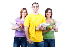 Students with notebooks and apples royalty free stock image