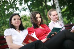 Students in the open air. Students in the fresh air, reading notes Royalty Free Stock Photo