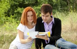 Students at outdoor doing homework. Royalty Free Stock Images