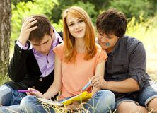 Students at outdoor doing homework. Royalty Free Stock Photos