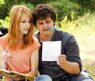 Students at outdoor doing homework. Stock Photo