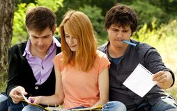 Students at outdoor doing homework. Stock Image