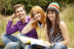 Students at outdoor doing homework. Royalty Free Stock Image