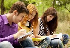 Students at outdoor doing homework. Royalty Free Stock Photo