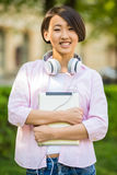 Students outdoors. Young attractive smiling student  outdoors on campus at the university Stock Images