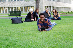 Students outside reviewing lessons Stock Photo