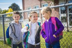 Students outside school standing together Royalty Free Stock Photos