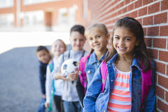 Students outside school standing together Stock Images