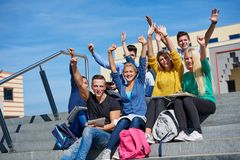 Students outside sitting on steps Royalty Free Stock Images